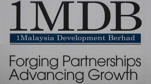 A billboard for state investment fund 1 Malaysia Development Berhad (1MDB) at the fund's flagship Tun Razak Exchange development in Kuala Lumpur, Malaysia. (AP Photo/Joshua Paul, File)