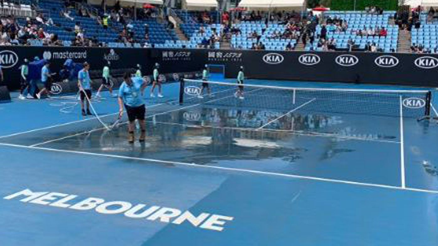 Australian Open play delayed by dust storm and rain, leaving visitors incredulous