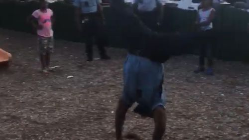 Police officer Arthur Brown Jr starts off with a cartwheel. (Facebook)