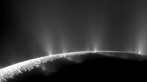 plumes of water ice and vapor from the south polar region of Saturn's moon Enceladus in 2005. (NASA)