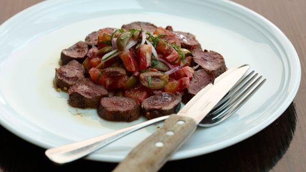 Harissa-rubbed kangaroo loin with blood orange, olive, Spanish onion and mint salad