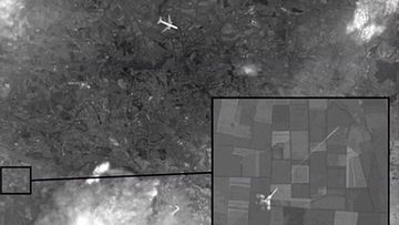 The alleged satellite image of MH17 with a Ukrainian fighter jet firing at it. (Channel One)
