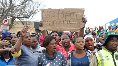 Protesters outside the Estcourt Magistrates Court during the appearance of suspects in the flesh-eating case last August.