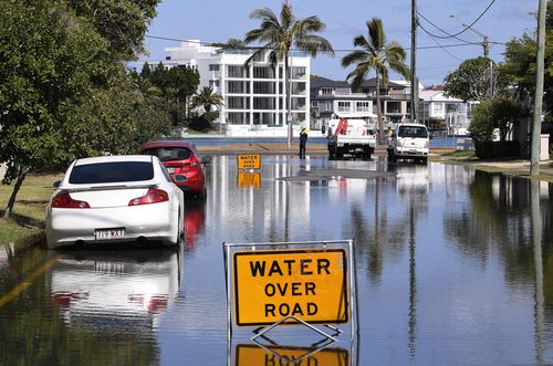 Flooding due to a king tide is seen on the Gold Coast. Huge swells and high tides are set to pummelling south-east Queensland beaches over the coming days as Cyclone Oma tracks towards the Queensland coast.