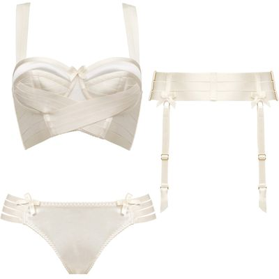 "<p><a href=""http://babylikestopony.com/collections/top/products/bondage-longline-wrap-bra-by-bordelle-cream"" target=""_blank"">Bondage Longline Wrap Bra, $430</a>, <a href=""http://babylikestopony.com/collections/bottom/products/webbed-thong-by-bordelle-cream"" target=""_blank"">Webbed Thong, $170</a>, and <a href=""http://babylikestopony.com/collections/bottom/products/strap-suspender-by-bordelle-cream"" target=""_blank"">Strap Suspender, $220</a>, Bordelle</p>"