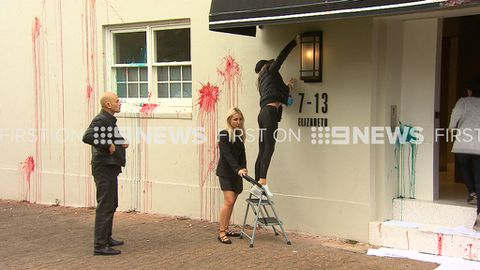 9RAW: Roxy Jacenko cleans the front of her office after it was vandalised