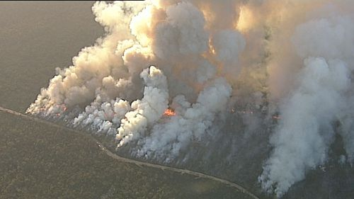 """An emergency warning was issued as homes come """"under ember attack"""" from the Holsworthy bushfire. (9NEWS)"""