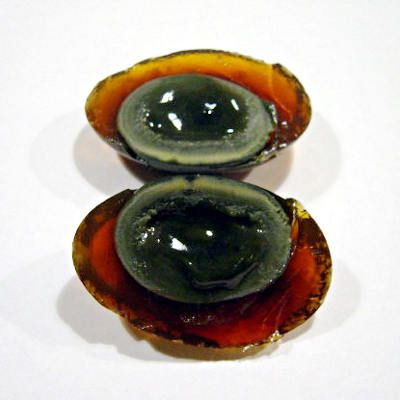 Known by many names, including hundred-year/thousand-year/millennium egg, a century egg is a preserved chicken, duck or quail egg. The eggs are packed in a mix of clay, lime, salt and ash and left to sit for three years or more.
