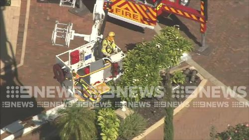 A rescue operation was launched to save the man using a sky lift before he was taken to hospital. Picture: 9NEWS.