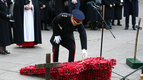 Crosses and poppies are place in the grounds of Westminster Abbey to remember those who have died during wars. (AAP)