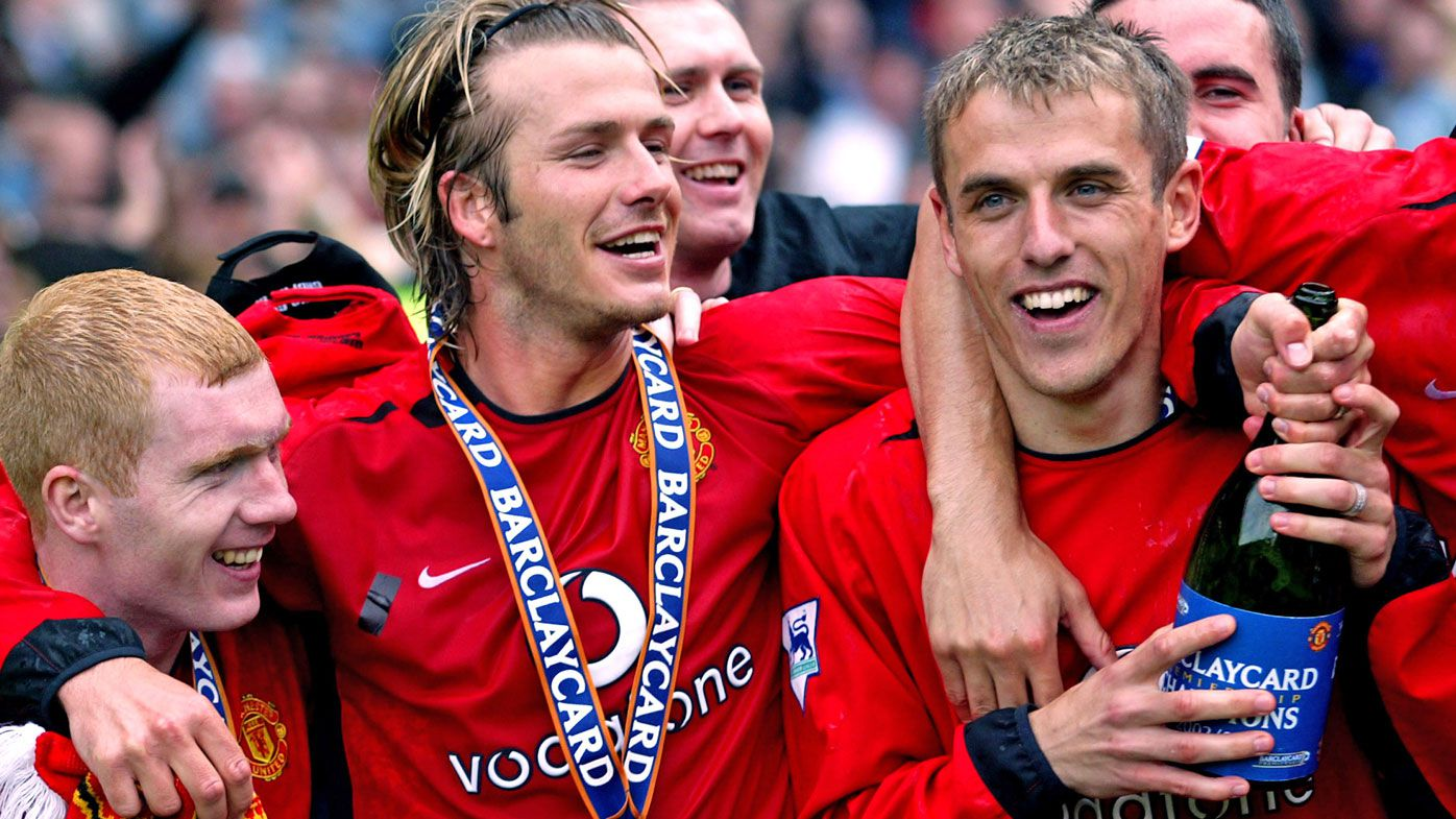 Manchester United's Paul Scholes, David Beckham and Phil Neville celebrate winning the Barclaycard Premiership trophy in 2003