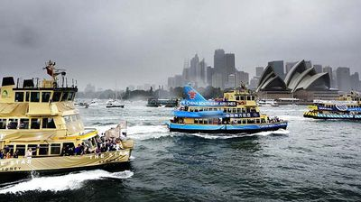Sydney's ferries opened the throttles on the harbour for a drag race to the famous bridge. (Getty)