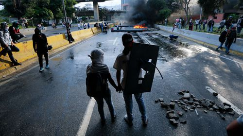 Protesters have maintained months of riots against the Maduro regime. (AAP)