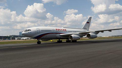 Mr Putin's jet was met by a waiting motorcade. Picture: EPA/AAP