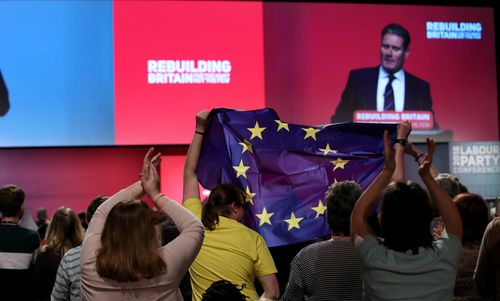 A European flag is waved at the Labour Party conference in Liverpool, England, as Brexit spokesman Keir Starmer speaks.
