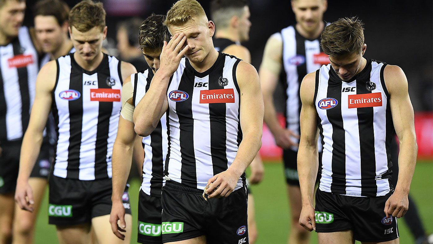 Collingwood's horror night compounded by calf injury to luckless forward Ben Reid