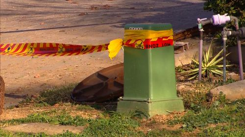 Police have locked down a home in Sydney's north west after a manhole cover exploded in the street.