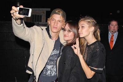 Cody Simpson and Gig Hadid enjoyed a selfie moment with a fellow partygoer.