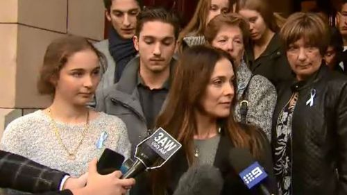 The victim's wife (right) said the sentence would allow them to 'breathe easier' but said 'it's not over.' (9NEWS)