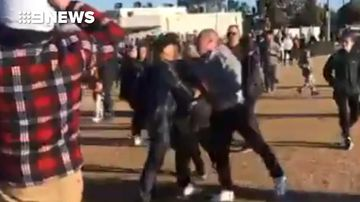 Umpire chased down by crowd at Melbourne junior football match