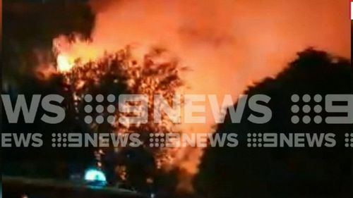 Firefighters remain on the scene this morning after the huge blaze overnight. (9NEWS)