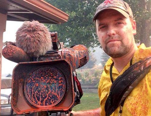 """""""The hazards of covering wildfires. Photographer Eric Jensen ... caught in the aftermath when a tanker dropped fire retardant in the area,"""" KOMO News posted on its Facebook page."""