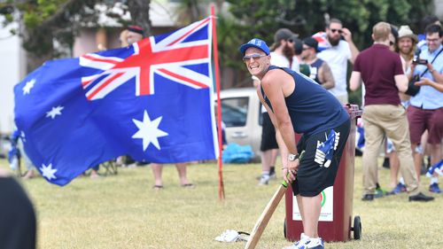 A man plays park cricket on Australia Day 2018 in Melbourne.