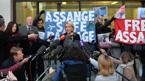 Jennifer Robinson, centre left, a lawyer representing Julian Assange, talks to the media outside Westminster Magistrates Court. (AAP)