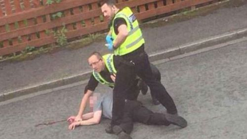 Police detain a man after MP Jo Cox was attacked. (Supplied)