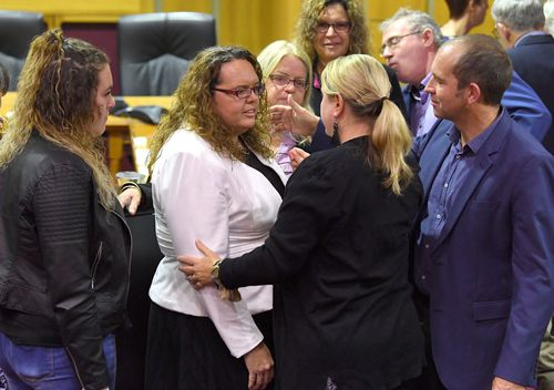 Cr Kerry Silver (left) is seen following the Ipswich City Council's final meeting at the Ipswich City Council Chambers