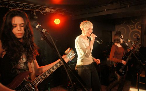Laura Croix on stage with her band. (Facebook)