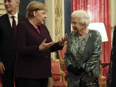 Her Majesty chats with Germany's chancellor Angela Merkel during palace reception for NATO leaders.