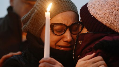 Valerie Reyes' mother, Norma Sanchez, grieves for her daughter during a candlelight vigil in New York last week.