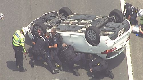 Police were quick to pounce making an arrest moments after the car flipped.