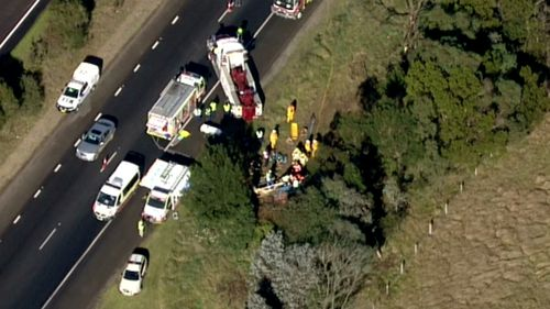 The driver was freed after being trapped for more than two hours. (9NEWS)