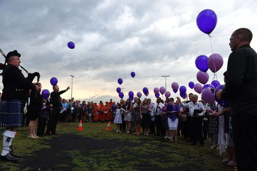 Mourners release purple balloons during Jayde's memorial service in Gatton. (Image: AAP)