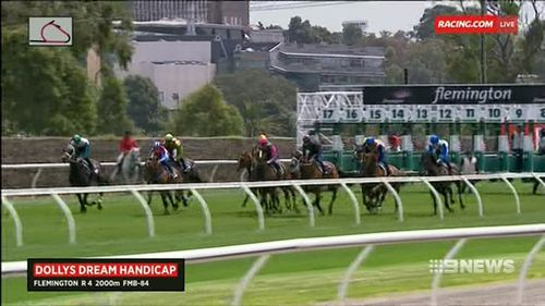 The 2000m race saw jockeys united in blue britches, which was Dolly's favourite colour. (9NEWS)
