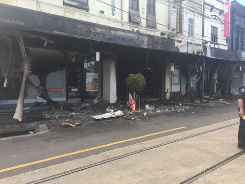 The blaze broke out on Glenferrie Road, Malvern, just after midnight. (9NEWS)