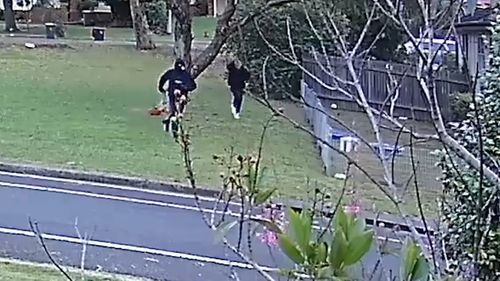 CCTV captures two men running through Colechin Reserve at Yagoona just after Mr Hamzy's murder. As one of the men flees, his hood falls from his head revealing his face and distinctive blond hair. The two men then leave the area in two luxury cars.