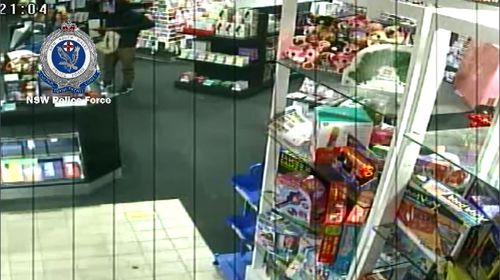The calm staff member appeared to not hand over any money before the armed man fled. Picture: Supplied.