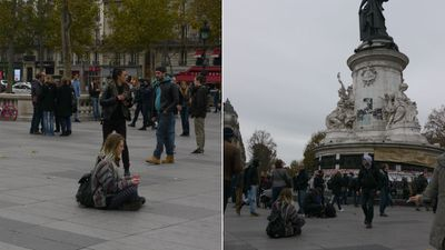 A young woman meditates among the mourners at Place de la Republique. (Jack Hawke, 9News.com.au)