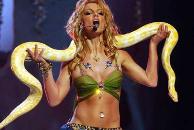 Good girl image is shattered thanks to Brit cavorting with one lucky python while performing 'Slave 4 U'.