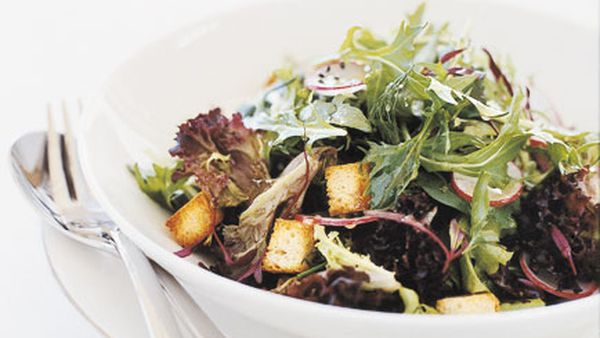 Salad farm lettuces with radishes, baby croutons and citrus vinaigrette