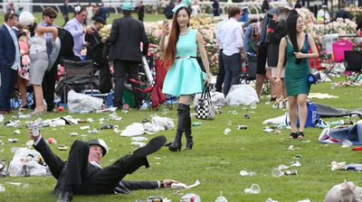 One man takes a tumble at the end of the day. (Photo: AAP Image/David Crosling)
