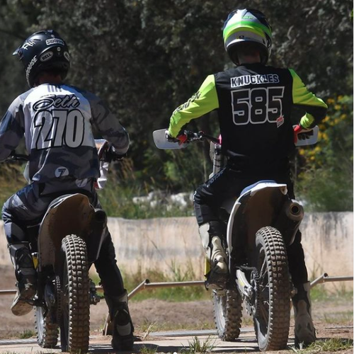 """Fellow racer Seth Qualischefski (left) shared a photo of himself and Gordon (right) on their bikes, remarking that he couldn't believe he'd """"never get to share a track"""" with him again."""