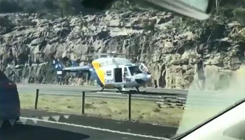 The Careflight helicopter landed on southbound lanes of the major motorway after the incident, closing all three lanes. Picture: Supplied.