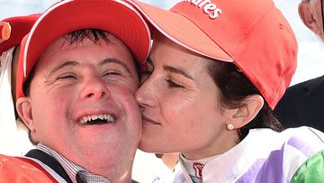 Steven (left) and Michelle Payne celebrate after Michelle rode Prince of Penzance to victory in the Melbourne Cup. (Photo: AAP Image/Julian Smith)