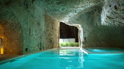 """<p><a href=""""https://www.airbnb.com.au/rooms/704540"""">Domus Civita</a> is a fully restored 14th century palazzo with impeccable design, connected to underground caves, etruscan thombs and a Roman water cistern.<br /> <br /> $499 AUDper night</p> <p>Photo: Airbnb</p>"""