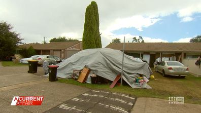 Why a woman turned her neighbour's front lawn into a campsite