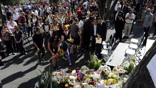 Mourners attend a memorial for Eunji Ban.
